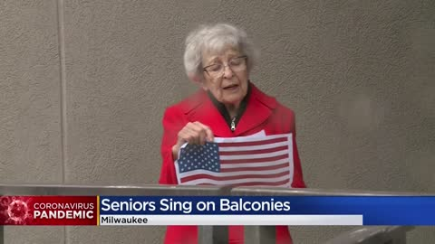 Milwaukee seniors sing, wave flags from balconies amid COVID-19...